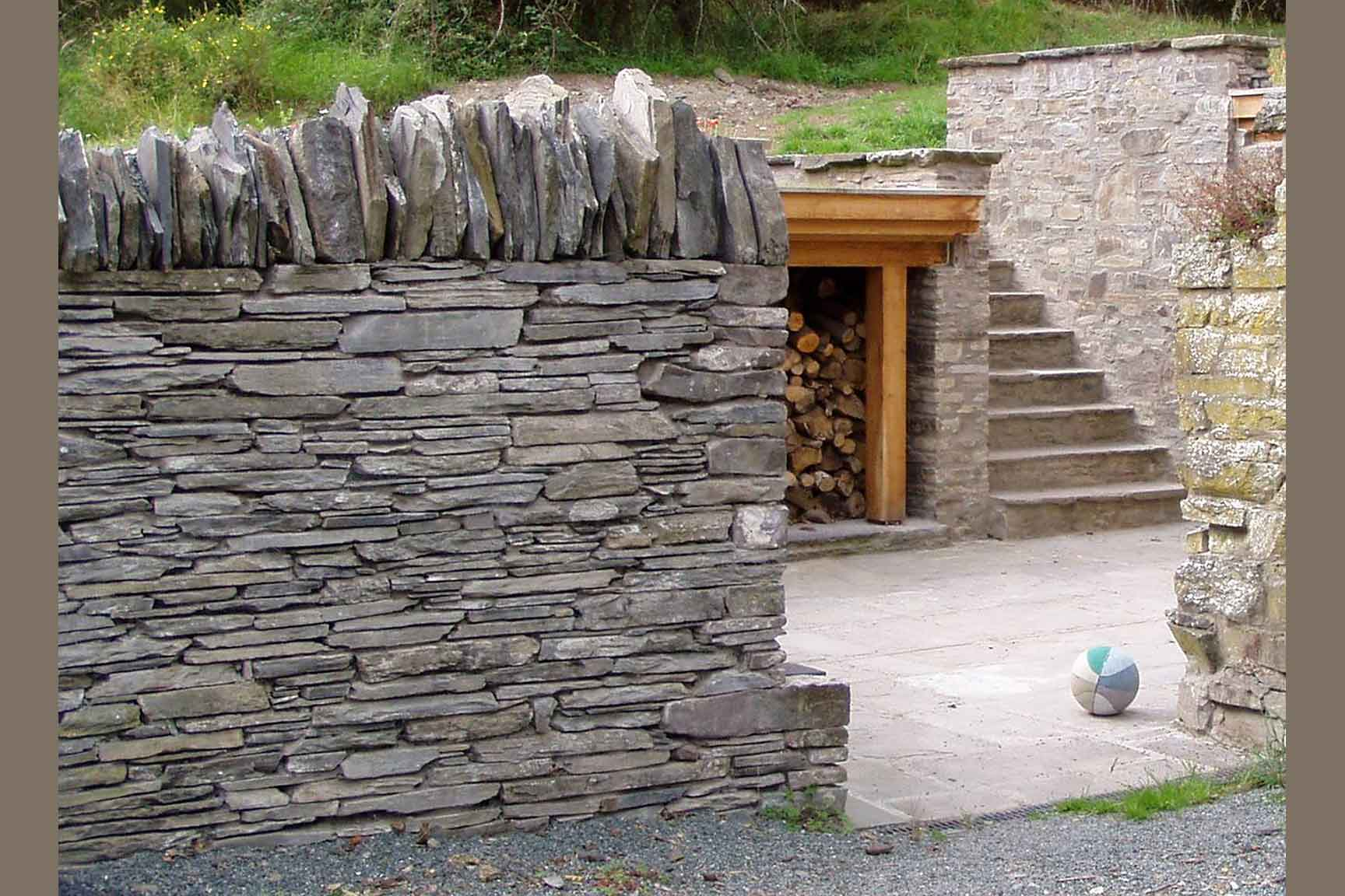 The Playbarn: drystone wall, steps, log store